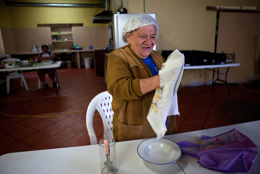 Canela, resident of Casa Xochiquetzal, cleans her dishes after lunch time at the shelter in Mexico City, Mexico on October 4, 2010. Casa Xochiquetzal is a shelter for elderly sex workers in Mexico City. It gives the women refuge, food, health services, a space to learn about their human rights and courses to help them rediscover their self-confidence and deal with traumatic aspects of their lives. Casa Xochiquetzal provides a space to age with dignity for a group of vulnerable women who are often invisible to society at large. It is the only such shelter existing in Latin America. Photo by Bénédicte Desrus
