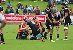Hayen Triggs is tended to by Zig Khouri and Ash Draper. Maori All Blacks vs. Fiji. Suva. MAB's won 27-26. July 11, 2015. Photo: Marc Weakley