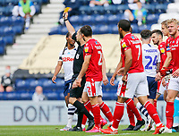 11th July 2020; Deepdale Stadium, Preston, Lancashire, England; English Championship Football, Preston North End versus Nottingham Forest; Referee Jeremy Simpson shows a yellow card to Andrew Hughes of Preston North End with both teams arguing his decision