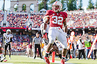 STANFORD, CA - SEPTEMBER 22, 2013: Anthony Wilkerson celebrates his  touchdown during Stanford's game against Arizona State. The Cardinal defeated the Sun Devils 42-28.