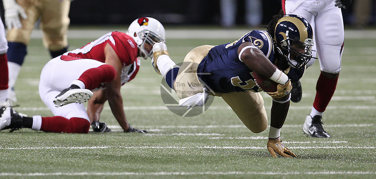 112711tvjacksondives.Rams Steven Jackson (39, right) stumbles and dives to the turf on a carry after being tripped up by a Cardinals defender in the first quarter.  The Arizona Cardinals defeated the St. Louis Rams 23-20..TIM VIZER/BELLEVILLE NEWS-DEMOCRAT
