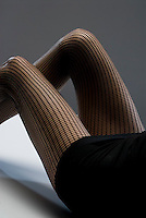 Woman's legs in fish net stockings