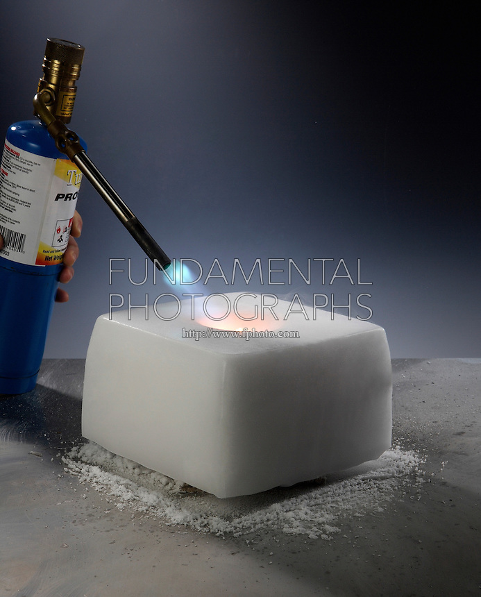 MAGNESIUM LANTERN IN DRY ICE<br /> (2 of 3)<br /> Igniting The Magnesium Turnings<br /> Magnesium is placed in a cavity in a block of dry ice. The magnesium is ignited and covered by another block of dry ice. Magnesium will take oxygen from solid carbon dioxide (CO2)  to form the remarkably stable compound, magnesium oxide.