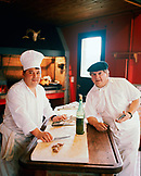 ARGENTINA, Bariloche, Llao Llao hotel, portrait of chef preparing food in kitchen