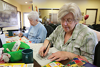 Verna Foresee (right) shades in a picture Friday, January 10, 2020, as she colors with Rosie Loy at the Lowell Senior Activity Center. The center is in the process of beginning regular art classes that will include painting, coloring and jewelry making. Check out nwaonline.com/200111Daily/ and nwadg.com/photos for today's photo gallery.<br /> (NWA Democrat-Gazette/David Gottschalk)