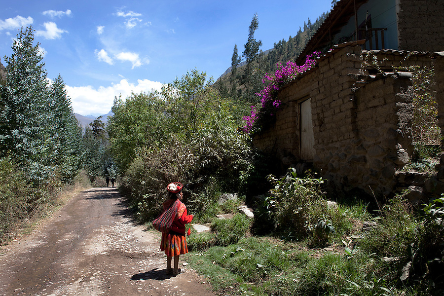Local indigenous Quechua girl visits a neighbor in Lares, Peru, Peruvian Andes