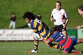 Haani Hala'eua is tackled by Kaino Kaino. McNamara Cup final - Premier 1 Championship, Patumahoe v Ardmore Marist. Patumahoe won 13 - 6. Counties Manukau club rugby finals played at Growers Stadium, Pukekohe, 24th of June 2006.