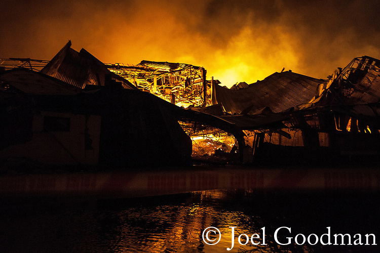 © Joel Goodman - 07973 332324 .22/12/2011 . Lancashire , UK . Fire fighters tackle a large fire spread across several buildings on an industrial estate at Enterprise Court on Spurrier Street, in Leyland . Photo credit: Joel Goodman