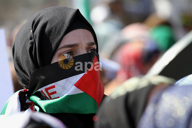 Palestinians take part in a protest against Jewish groups visiting the al-Aqsa mosque compound and in support the Palestinians in the West Bank, in Gaza city on October 10, 2015. Fifteen Palestinians have been killed by Israeli forces and around 1,000 injured with live and rubber-coated steel bullets in the occupied West Bank and Gaza Strip since Oct. 1. Photo by Mohammed Asad