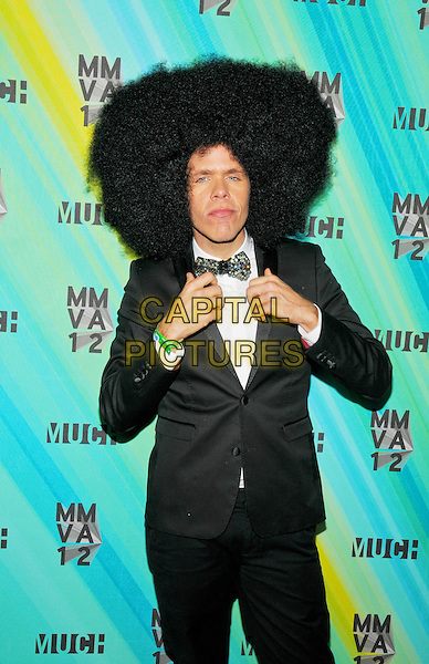 Perez Hilton poses in the press room at the 23rd Annual MuchMusic Video Awards at the MuchMusic HQ, Toronto, Ontario, Canada. .June 17th, 2012.half length black suit tuxedo white shirt bow tie wig afro hair hands adjusting silver .CAP/ADM/BPC.©Brent Perniac/AdMedia/Capital Pictures.