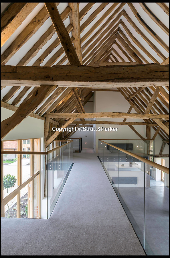 BNPS.co.uk (01202 558833)<br /> Pic: Strutt&Parker/BNPS<br /> <br /> Old meets new - the 400 year old oak beams frame the modern open plan interior.<br /> <br /> These stark before and after pictures show the remarkable transformation of a dilapidated barn into a luxurious home worth £1.25million. <br /> <br /> The ramshackle 16th century structure on a derelict farm was in a state of near ruin before developer Mark Parmenter undertook the colossal project - his first ever barn conversion. <br /> <br /> Mr Parmenter, 60, identified the magnificent 400-year-old beams as the centrepiece of his project. <br /> <br /> Despite the decrepit exterior, which pictures show to have been rusty and crumbling, he was pleasantly surprised to find the inside in remarkably good condition. <br /> <br /> The property is now on the market with Strutt & Parker.