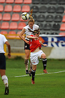 Rachel Buehler wins a header over an unidentified Norwegian player.  The USA defeated Norway 2-1 at Olhao Stadium on February 26, 2010 at the Algarve Cup.
