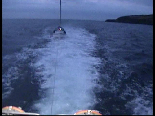 Video still of a yacht with the solo sailor being towed into Wicklow Photo: RNLI