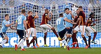 Calcio, Serie A: Roma vs Lazio. Roma, stadio Olimpico, 8 novembre 2015.<br /> Lazio's Antonio Candreva, center, back to camera, kicks a free kick during the Italian Serie A football match between Roma and Lazio at Rome's Olympic stadium, 8 November 2015.<br /> UPDATE IMAGES PRESS/Riccardo De Luca