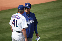 MESA, AZ - MARCH 6:  Manager Joe Torre of the Los Angeles Dodgers talks with Chicago Cubs manager Lou Piniella during their spring training game at HoHoKam Park in Mesa, Arizona on March 6, 2009.  Photo by Brad Mangin