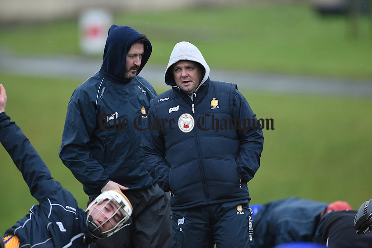 Clare manager Davy Fitzgerald and  coach/selector Donal Og Cusack oversee the warm up  before their Munster Senior Hurling League Round Four game against Waterford at Carriganore. Photograph by John Kelly.