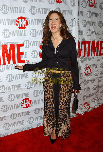KELLY PRESTON.Fat Actress Los Angeles Premiere held at the Cinerama Dome at Arclight Cinemas. Hollywood, California.Photo Credit: Laura Farr/AdMedia.February 23rd, 2005.full length animal print leopard print skirt black top jacket black purse laughing mouth open funny gesture.www.capitalpictures.com.sales@capitalpictures.com.© Capital Pictures.