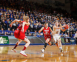 BROOKINGS, SD - JANUARY 17:  Macy Miller #12 from South Dakota State drives against Allison Arens #10 from the University of South Dakota in the first half of their game Sunday afternoon at Frost Arena in Brookings, S.D. (Photo by Dave Eggen/Inertia)