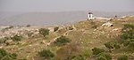 Umm Qais, northwestern Jordan:  A small shed tops the promontory where the city wall orginially bordered the biblical town of Gadara (capital of the Gadarenes).  © Rick Collier