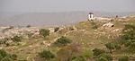 Umm Qais, northwestern Jordan:  A small shed tops the promontory where the city wall orginially bordered the biblical town of Gadara (capital of the Gadarenes).  © Rick Collier