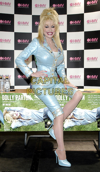 """DOLLY PARTON.signs copies of her new album """"Halos and Horns"""" at HMV.busty, pedal pushers, fashion disaster.www.capitalpictures.com.sales@capitalpictures.com.© Capital Pictures"""