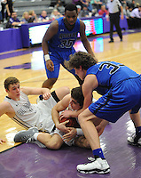 NWA Democrat-Gazette/ANDY SHUPE<br /> Rogers wing Garrett Dake (right) ties up Fayetteville forward Nick Scalise Friday, Feb. 10, 2017, during the second half of play in Bulldog Arena. Visit nwadg.com/photos to see more photographs from the game.