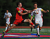 Brendan Slattery #9 of Chaminade, right, gets challenged by Owen McCrave #21 of St. John the Baptist during a NSCHSAA varsity boys soccer match played at St. John the Baptist High School on Tuesday, Sept. 11, 2018. Chaminade won by a score of 4-3.