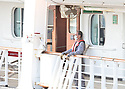 FORT LAUDERDALE, FL - April 02: A workers standing out in the deck of The Rotterdam cruise ship docks at Port Everglade in Florida on April 02, 2020 in Fort lauderdale, Florida. The Holland America cruise line ship had been at sea for the past 19 days after South American ports denied their entry due to the Coronavirus outbreak. Reports indicated that two of four people that died aboard the Zaandam had tested positive for COVID-19. Those passengers that are fit for travel in accordance with guidelines from the U.S. Centers for Disease Control will be permitted to disembark.   ( Photo by Johnny Louis / jlnphotography.com )