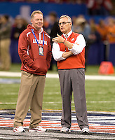 Ohio State head coach Jim Tressel talks with Arkansas head coach Bobby Petrino before the game during 77th Annual Allstate Sugar Bowl Classic at Louisiana Superdome in New Orleans, Louisiana on January 4th, 2011.  Ohio State defeated Arkansas, 31-26.