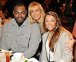 From left: Michael Oher, Leigh Anne Touhy and Collins Touhy at the Arrow Child & Family Ministries Ambassador Luncheon at the InterContinental Hotel Thursday March 4,2010. (Dave Rossman Photo)