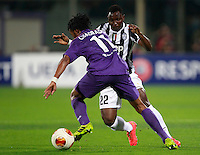 Calcio, ritorno degli ottavi di finale di Europa League: Fiorentina vs Juventus. Firenze, stadio Artemio Franchi, 20 marzo 2014. <br /> Fiorentina midfielder Juan Cuadrado, of Colombia, is challenged by Juventus midfielder Kwadwo Asamoah, of Ghana, right, during the Europa League round of 16 second leg football match between Fiorentina and Juventus at Florence's Artemio Franchi stadium, 20 March 2014. Juventus won 1-0 to advance to the round of eight.<br /> UPDATE IMAGES PRESS/Isabella Bonotto