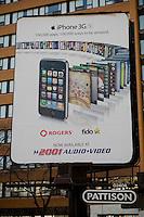 A Pattison advertisement board for Rogers and Fido iPhone is seen in Toronto April 19, 2010.