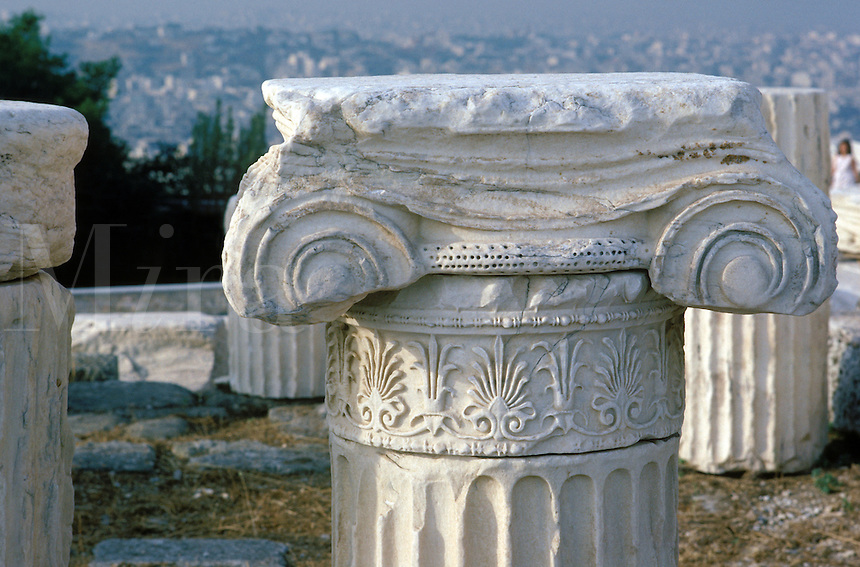 On the Acropolis, many pieces of fallen buildings abound. This upper portion of a fluted column has a damaged Ionic capital sitting on top.