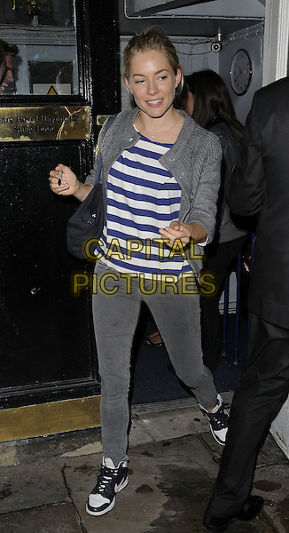 "Sienna Miller.Departing after an evening performance of ""Flare Path"", Theatre Royal, London, England..June 10th, 2011.full length grey gray jeans denim white blue top stripe jacket sneakers trainers hitop high top.CAP/CAN.©Can Nguyen/Capital Pictures."