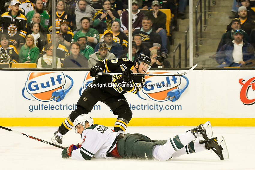 March 17, 2014 - Boston, Massachusetts , U.S. - Boston Bruins left wing Daniel Paille (20) shoots during the NHL game between the Minnesota Wild and the Boston Bruins held at TD Garden in Boston Massachusetts. The Bruins defeated the Wild 4-1 at the end of regulation.  Eric Canha/CSM