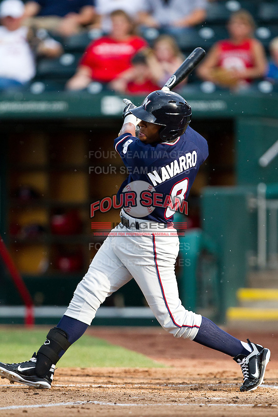 Rey Navarro (8) of the Northwest Arkansas Naturals follows through his swing during a game against the Springfield Cardinals at Hammons Field on July 31, 2011 in Springfield, Missouri. Northwest Arkansas defeated Springfield 9-1. (David Welker / Four Seam Images)