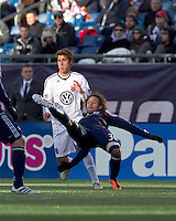 New England Revolution defender Kevin Alston (30) clears the ball. In a Major League Soccer (MLS) match, the New England Revolution defeated DC United, 2-1, at Gillette Stadium on March 26, 2011.