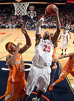 Virginia forward Akil Mitchell (25) shoots next to Tennessee forward Jarnell Stokes (5) during the game Wednesday in Charlottesville, VA. Virginia defeated Tennessee 46-38.