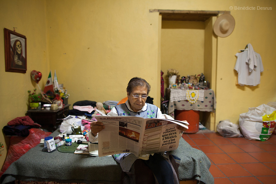 Normita, a resident of Casa Xochiquetzal, reads a newspaper in her bedroom at the shelter in Mexico City, Mexico on October 31, 2012. Casa Xochiquetzal is a shelter for elderly sex workers in Mexico City. It gives the women refuge, food, health services, a space to learn about their human rights and courses to help them rediscover their self-confidence and deal with traumatic aspects of their lives. Casa Xochiquetzal provides a space to age with dignity for a group of vulnerable women who are often invisible to society at large. It is the only such shelter existing in Latin America. Photo by Bénédicte Desrus