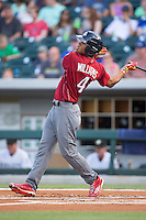 Nick Williams (4) of the Lehigh Valley Iron Pigs follows through on his swing against the Charlotte Knights at BB&T BallPark on June 3, 2016 in Charlotte, North Carolina.  The Iron Pigs defeated the Knights 6-4.  (Brian Westerholt/Four Seam Images)