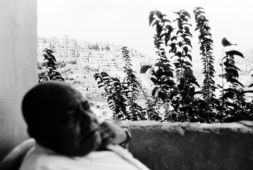 Jaddou, from Baghdad, sits on the balcony of his small home in Amman, Jordan, September 2009. Photo: Ed Giles.