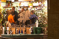 A bar and wine shop seen through the window. Sitges, Catalonia, Spain