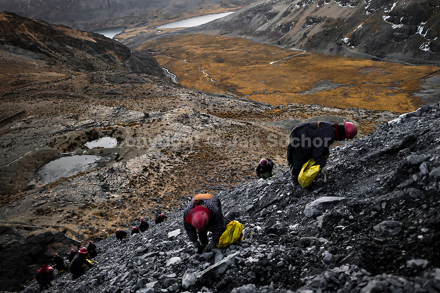 Pallaqueras, female gold miners, pick through the tailings, searching for gold around the gold mines in La Rinconada, Peru, 4 August 2012. During the last decade, the rising price of the gold has attracted thousands of people to La Rinconada in the Peruvian Andes. At 5300 metres above sea level, nearly 50.000 people work in the gold mines and live in the nearby colonies without running water, sewage system or heating service. Although the work in the mines is very dangerous (falling rocks, poisonous gases and a shifting glacier), the majority of miners have no contract and operate under the cachorreo system - working 30 days without payment and taking the gold they supposedly find the 31st day as the only salary. In spite of a demaged environment, caused by mercury contamination from the mining and the lack of garbage disposal, people continue to flock to the region hoping to find their fortune.