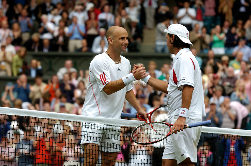 Photo: Richard Lane..Wimbledon Championships. 27/06/2006. .USA's Andre Agassi (lt) celebartes victory with Boris Pashanski of Serbia and Montenegro.