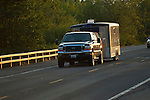 Black Ford towing enclosed trailer