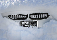 A vehicle remains snow covered as the region cleans up after Winter Storm Jonas Sunday January 24, 2016 in Newtown, Pennsylvania. (Photo by William Thomas Cain)