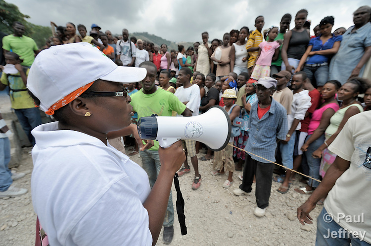 An emergency worker for the ACT Alliance gives instructions to a crowd gathered for a food distribution in the Santa Teresa camp in Petionville, Haiti, on February 1. Hundreds of families left homeless by the devastating January 12 earthquake live here. The ACT Alliance sponsored this distribution of food, buckets, and hygiene kits.