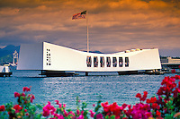 The U.S.S. Arizona Memorial located in Pearl Harbor commemorates those sailors and marines lost during the Japanese attack of 1941. The memorial spans the sunken battleship Arizona where over a thousand sailors and marines lie interred.