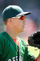 Center fielder Bryan Hudson (18) of the Greenville Drive warms up before a game against the Charleston RiverDogs on Sunday, June 28, 2015, at Fluor Field at the West End in Greenville, South Carolina. Charleston won, 12-9. (Tom Priddy/Four Seam Images)