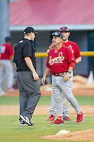 Johnson City Cardinals manager Johnny Rodriguez (18) discusses a call with umpire Russ Weich during the game against the Burlington Royals at Burlington Athletic Park on July 14, 2014 in Burlington, North Carolina.  The Cardinals defeated the Royals 9-4.  (Brian Westerholt/Four Seam Images)